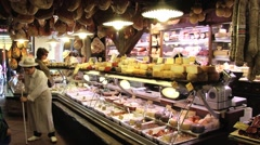 People buy cheese in a shop in Bologna, Italy. - stock footage