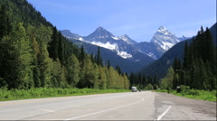 Trans-Canada Highway and the mountains of Glacier National Park, Canada Stock Footage