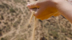 Sand Falling From Hand closeup Stock Footage