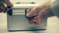 Wad of money put in a light colored metal suitcase on the white background - stock footage