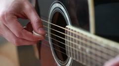 Man playing on black guitar. mediator Stock Footage