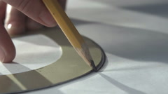 Hand of female tailor drawing pattern at paper in her studio Stock Footage