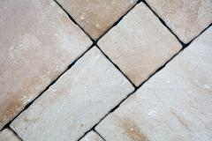 Background of granite paving stones stacked, paver and cube Stock Photos
