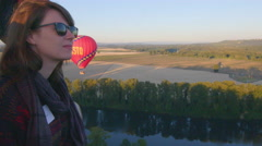 Woman in hot air balloon smiles - stock footage