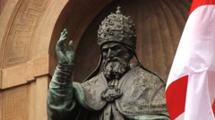 Statue of the Pope Gregory XIII at the facade of the cityhall in Bologna, Italy. - stock footage