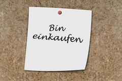 Bin einkaufen written on a memo Stock Photos