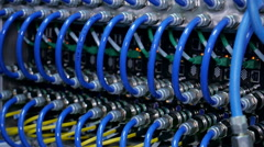 wires, lightbulbs and computer parts in render farm - stock footage