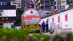 Petrol station: Workers detected tanker Stock Footage