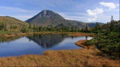 View of Sanno pond and Mount Rausu, Hokkaido, Japan Stock Footage