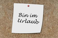Bin im Urlaub written on a memo - stock photo