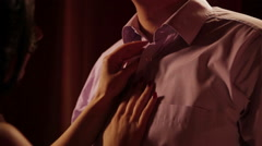 Wife unbuttoning shirt husband Stock Footage