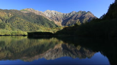 Autumn foliage and the Hotaka mountain range from Kamikochi in Nagano Prefecture Stock Footage