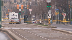 Police officers at shooting murder scene in downtown Toronto Stock Footage