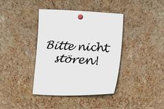 bitte nicht stören written on a memo - stock photo