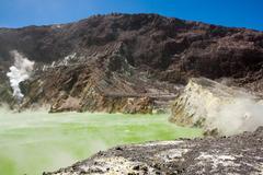 Stock Photo of Crater lake, yellow smoking water (acid, sulfur).