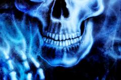 Detailed skull and skeleton hand and blue fire, on black background Stock Illustration