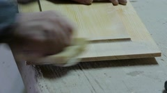 Polishing of wooden part by hand. - stock footage