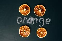 Four cup sliced orange on a black background board Stock Photos