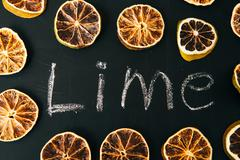 Many cut orange circle on a black background board Stock Photos