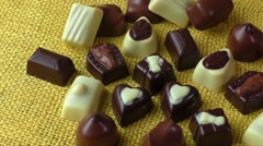 Assortment of dark, white and milk chocolate - stock footage