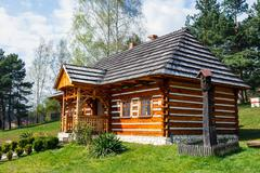 Old log hause in an open-air ethnography museum in Wygielzow, Poland - stock photo