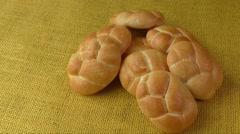 Fresh wheat buns on the sacking background Stock Footage