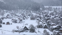 View of the snow covered Shirakawa Village from Shiroyama Observatory Deck, Gifu Stock Footage