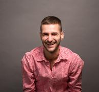 Smiling model man in studio - stock photo