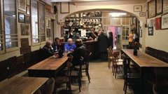 People talk in a traditional cafe (osteria) in Bologna, Italy. Stock Footage