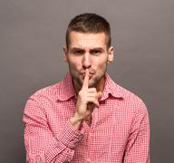 Man making a shushing gesture Stock Photos