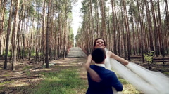 Romantic Couple Dancing in a fores in Slow Motion Stock Footage