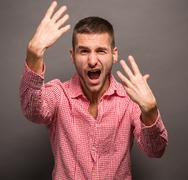 Young man with his hands in air Stock Photos