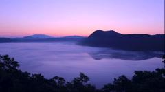Dawn fog over Lake Mashu in Hokkaido Stock Footage