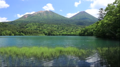 Lake Onneto Mount Meakan and Mt. Akan-Fuji, Hokkaido, Japan Stock Footage