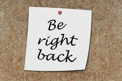 Be right back written on a memo Stock Photos