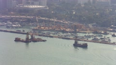 Dredging Barges in the Channel and Urban Traffic in Hong Kong. Video 4k Stock Footage