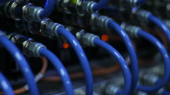 Wires, lightbulbs and computer parts in render farm Stock Footage