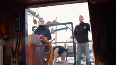 Crew members on the deck (at the helm) on a tall ship. Stock Footage
