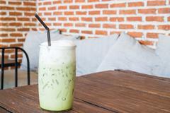 Green tea latte into a cold glass - stock photo