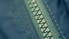 Hand unzipped and fasten blue plastic zipper on blue clothes. Macro Stock Footage