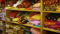 Folded Clothes on Display on the Shelves of a Shop. UltraHD video Stock Footage