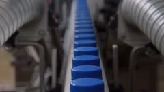 Conveyor with milk  bottles - stock footage