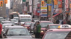 Toronto crowded Chinatown district with people and traffic jam Stock Footage