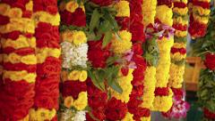 Floral Leis for Sale in an Outdoor Public Market. Video 4k Stock Footage