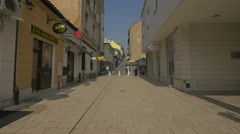 People walking on Gazi Husrev-begova in Sarajevo Stock Footage