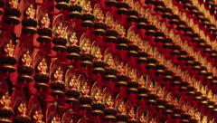 Hundreds of Identical, Miniature Buddha Statues at the Temple Stock Footage