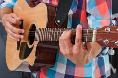 Acoustic guitar being played. Stock Photos