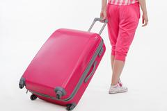 Girl traveller with pink suitcase. - stock photo