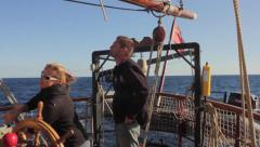 Stock Video Footage of Single female crew member at the helm on a tall ship in the Canary Islands