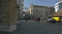 People walking by the Sacred Heart Cathedral in Sarajevo Stock Footage
